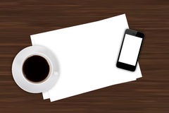 Smart Phone and Coffee on Office Table royalty free stock image