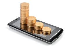 Smart phone and coin. On white background Stock Images