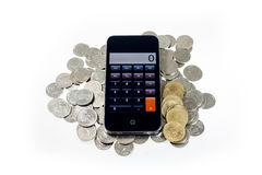 Smart phone with coins on isolate Royalty Free Stock Images
