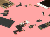 Smart phone components isolate on pink background Royalty Free Stock Images