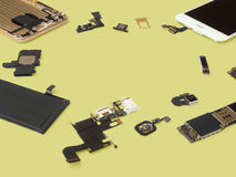 Smart phone components isolate on Yellow background Stock Image