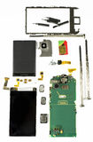 Smart phone components. Modern smart phone dismantled with main electronic components displayed together and screwdrivers ,against a white background Stock Photos