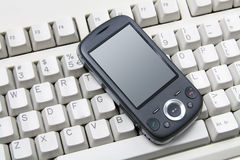 Smart Phone on Computer Keyboard Stock Photography