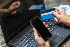 Smart phone and computer for on line payment Stock Photography