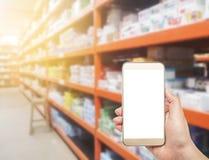 Smart Phone con il deposito della farmacia Fotografie Stock Libere da Diritti