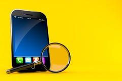Smart Phone con la lente d'ingrandimento Fotografia Stock Libera da Diritti