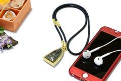 Smart Phone con le cuffie Fotografie Stock Libere da Diritti