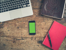 Smart phone concept with books and laptop Royalty Free Stock Photography
