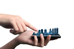 Smart phone. Concept of smart phone send e-mail from urban life. Double layers view of city scape and indoor hand isolated on white background Royalty Free Stock Images