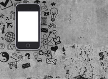 Smart phone on concrete floor with various social Royalty Free Stock Images