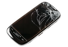 Smart Phone With Cracked Broken Screen Isolated Over White Backg. Black Mobile Smart Phone With Cracked Broken Screen Isolated Over White Background royalty free stock image