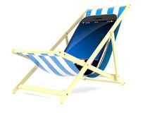 Smart phone on deck chair. Isolated on white background Royalty Free Stock Photos