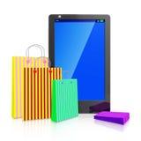 Smart Phone del touch screen con i sacchetti della spesa Fotografie Stock Libere da Diritti