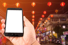 Smart Phone del touch screen dello spazio in bianco della tenuta della mano dell'uomo Immagine Stock