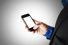 Smart Phone della tenuta dell'uomo d'affari, con lo spazio della copia, fuoco selettivo fotografia stock libera da diritti