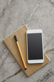 Smart Phone on the Desk Royalty Free Stock Image