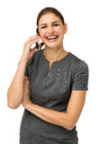 Smart Phone di Laughing While Using della donna di affari Immagini Stock Libere da Diritti