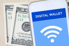 Smart phone with digital wallet on sceen over dollar bills Royalty Free Stock Photos