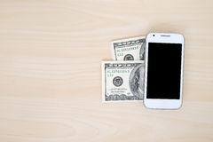 Smart phone and dollar bills, mobile payment concept Stock Photos