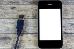 Smart Phone e cavo del usb Immagini Stock Libere da Diritti