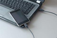Smart Phone e computer portatile Immagine Stock Libera da Diritti