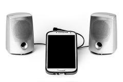 Smart Phone e schermo in bianco degli altoparlanti Immagini Stock