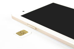 Smart Phone e SIM Card su fondo bianco Fotografie Stock