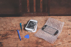 Smart Phone e strumenti rotti Fotografia Stock