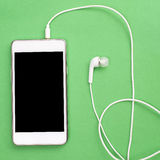 Smart phone with earphones Stock Photography