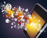 Smart phone emits letters, numbers and smoke Stock Photo