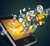 Smart phone emits letters, numbers and smoke Royalty Free Stock Photo