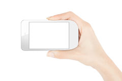 Smart phone in female hand. Royalty Free Stock Photos
