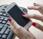 Smart-phone. Female hands using a Smartphone Stock Photos