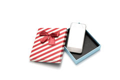 Smart phone and gift box Stock Image