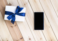 Smart Phone And Gift Box. Stock Photos