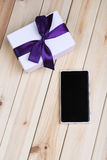 Smart Phone And Gift Box. Royalty Free Stock Image