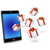 Smart phone and gift boxes Royalty Free Stock Images