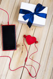Smart Phone, Gift And Red Heart. Royalty Free Stock Photo