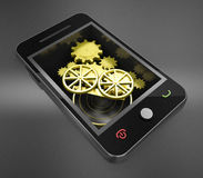 Smart phone and gold gears. 3d high quality render Royalty Free Stock Photo