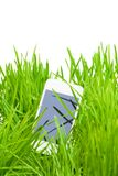 Smart phone in grass Royalty Free Stock Photos
