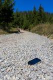 A smart phone on gravel rocks Royalty Free Stock Photo