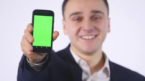 Smart phone with green screen in hand of businessman stock video
