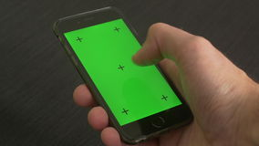 Smart Phone green screen. Swiping on a Apple Iphone 6 with green screen