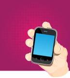 Smart phone in hand Stock Image