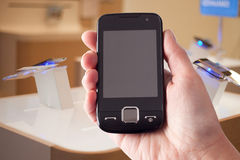 Smart phone in hand Royalty Free Stock Photo