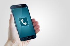 Smart phone in hand calling. Mockup Stock Image