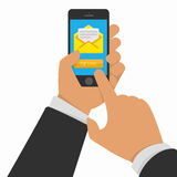 Smart phone in hand with email. Vector illustration of hand touching smart phone with Email symbol on the screen. Messaging concept. Message send on mobile phone Stock Photography