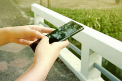 Smart phone on hand garden blur background. Smart phone business on hand garden blur background stock photography
