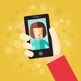 Smart phone in hand. On the yellow background with envelopes.  Stock Image
