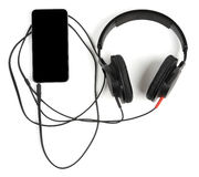 Smart phone with headphones Stock Photography
